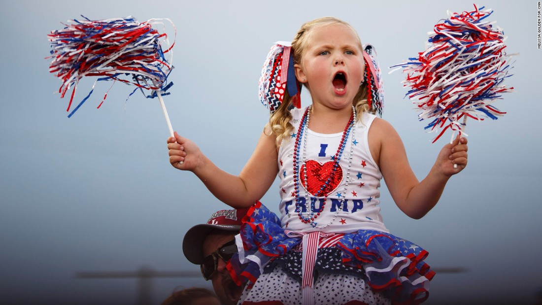 "Laci Lamb, 6, declares Trump ""awesome"" and cheers at a Trump rally in Mobile, Alabama, on August 21. Her mother, Annie, made her outfit. ""He's the best candidate we've had in a long time,"" Annie Lamb said."