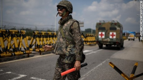 A South Korean soldier stands at a checkpoint on the Unification Bridge leading to North Korea near the border village of Yeoncheon in the Demilitarized Zone (DMZ) on August 22, 2015. South Korean troops stood at maximum alert on August 22, hours before the expiry of a North Korean ultimatum for Seoul to halt loudspeaker propaganda broadcasts across the border or face military action.       AFP PHOTO / Ed Jones        (Photo credit should read ED JONES/AFP/Getty Images)