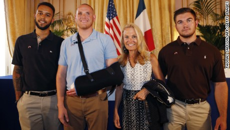 From left: Anthony Sadler, Spencer Stone, Alek Skarlatos and U.S. ambassador to France Jane Hartley pose after a press conference at the U.S. Embassy in Paris on August 23, 2015.