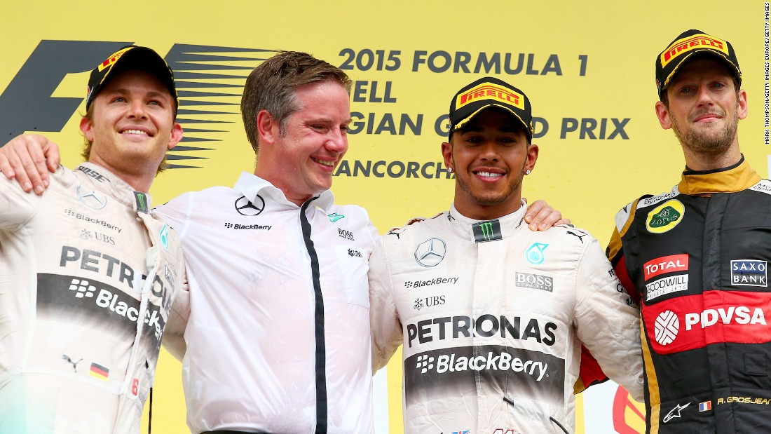 Hamilton celebrates his Belgian GP win as he stretches his lead over Mercedes teammate Nico Rosberg to 28 points in the title race.