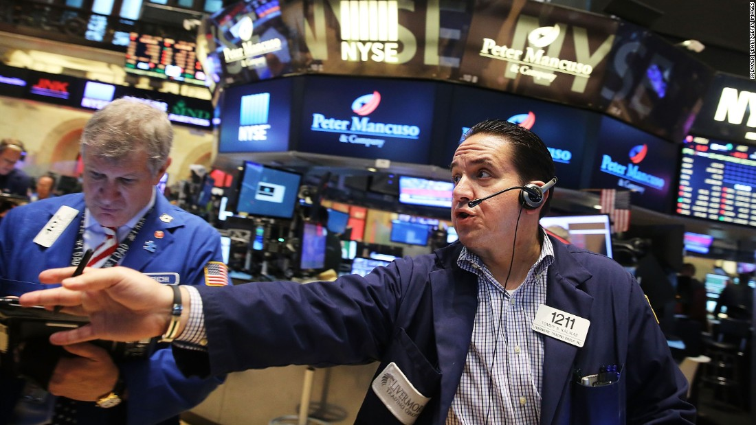 Traders work on the floor of the New York Stock Exchange on Friday, August 21, in New York City. The Dow continued to fall on August 24 as worries about China caused a global sell-off.