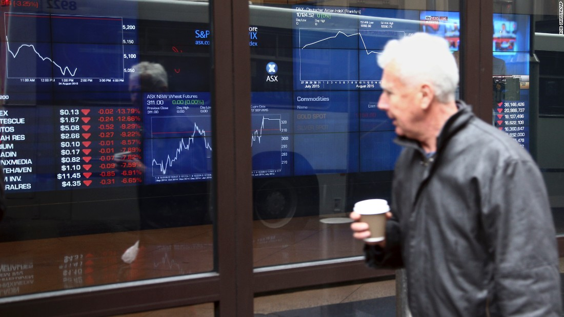 A man looks at the ASX trading board outside Exchange Square in Sydney, Australia, on August 24.