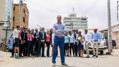 Mark Essien with his growing Hotels.ng team on Olonade street in Sabo, Yaba, Lagos.