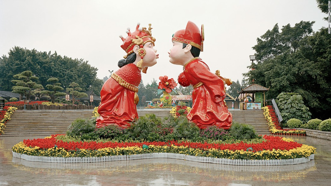 This life-sized statue of a popular figurine portrays a happy Chinese couple dressed in traditional wedding garb. In China, the color red is a symbol of love, prosperity, and happiness.