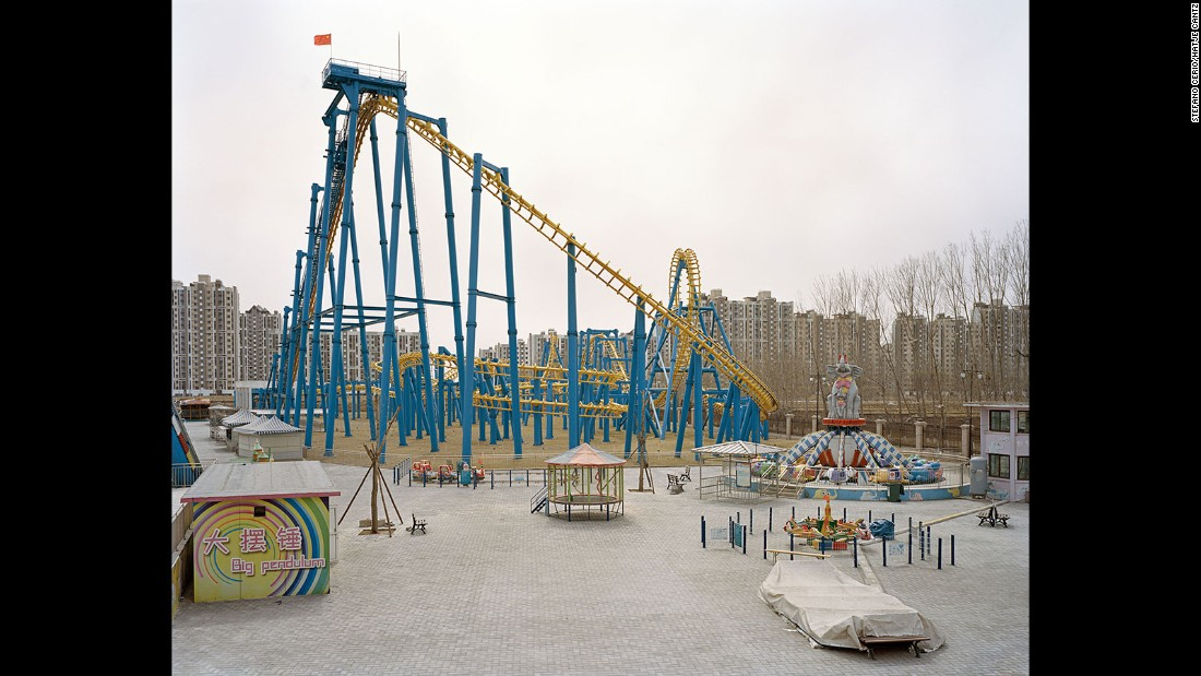 This thin, wiry rollercoaster, found at the Xiedao Holiday Village theme park, is juxtaposed with the density of the surrounding residential blocks.