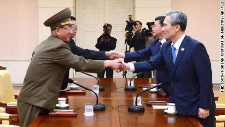 FILE - In this Aug. 22, 2015 file photo provided by the South Korean Unification Ministry, South Korean National Security Director, Kim Kwan-jin, right, and Unification Minister Hong Yong-pyo, second from right, shake hands with Hwang Pyong So, left, North Korea' top political officer for the Korean People's Army, and Kim Yang Gon, a senior North Korean official responsible for South Korean affairs, during their meeting at the border village of Panmunjom in Paju, South Korea. Once again, the Koreas are trying to disentangle themselves from violence and threats of war _ this time in tense talks that have dragged out in two marathon sessions over three days. Skepticism over success abounds, but the rivals have proven time and again over the decades their mastery at pulling back from the brink.  (The South Korean Unification Ministry via AP, File)