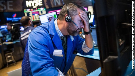 NEW YORK, NY - AUGUST 20:  A trader works on the floor of the New York Stock Exchange during the afternoon of August 20, 2015 in New York City. The Dow Jones continued its plunge south, losing over 350 points today.  (Photo by Andrew Burton/Getty Images)
