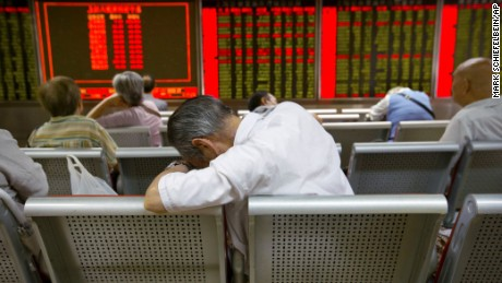 Chinese investors monitor stock prices at a brokerage house in Beijing, Tuesday, Aug. 25, 2015.  China's main stock market index has fallen for a fourth day, plunging 7.6 percent to an eight-month low.  (AP Photo/Mark Schiefelbein)