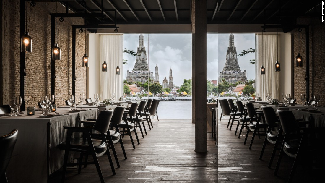 "This Bangkok restaurant's design is from local practice <a href=""http://www.onion.co.th/"" target=""_blank"">Onion</a>. Located on the banks of the Chao Phraya river, overlooking the legendary temple of the dawn (Wat Arun), modern interior design is folded into spiritual surroundings. <br /><br />Design by Onion, Photo by Wison Tungthunya, W Workspace from Let's Go Out Again, Copyright Gestalten 2015"