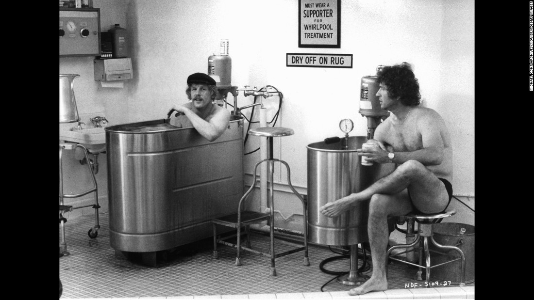 """Receiver Nick Nolte talks to quarterback Mac Davis while sitting in a whirpool bath in a scene from the 1979 film """"North Dallas Forty."""" It took a cynical look at pro football."""