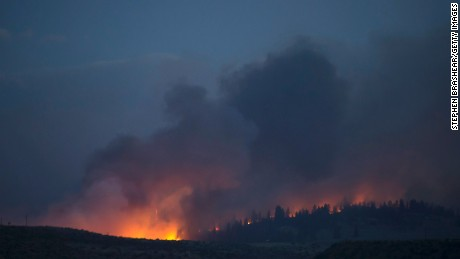 OMAK, WA - AUGUST 21: A wildfire, which is part of the Okanogan Complex, flares up on August 21, 2015 in the hills near Omak, Washington. The fires, which killed three firefighters and critically injured another, threaten homes and communities throughout the area. (Photo by Stephen Brashear/Getty Images)
