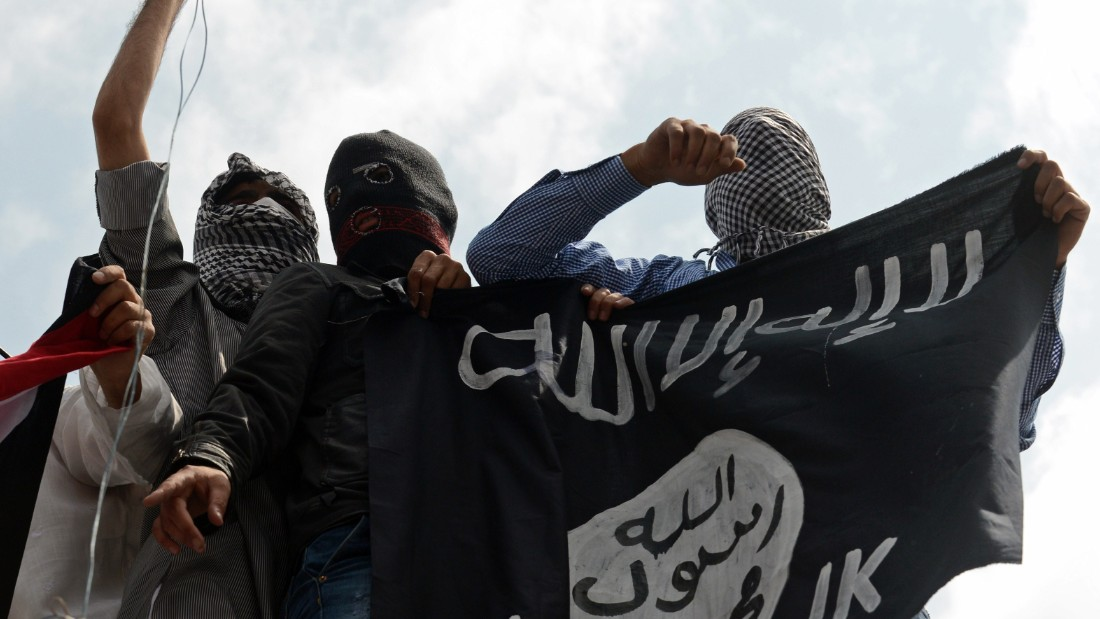 Kashmiri demonstrators hold up a flag of the Islamic State of Iraq and the Levant (ISIL) during a demonstration against Israeli military operations in Gaza, in downtown Srinagar on July 18, 2014.