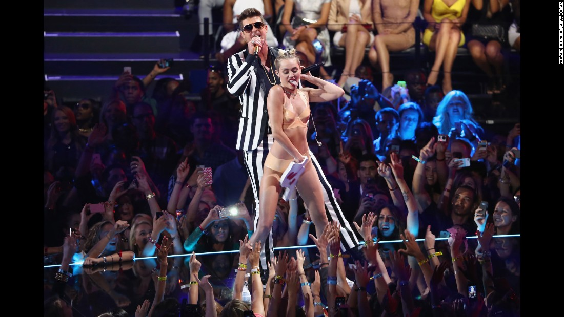 Twerking Miley Cyrus (with Robin Thicke during the 2013 MTV Video Music Awards at in New York) was a far cry from the child star many remembered.