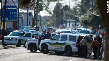 Police gather at the scene of a shooting in Sunset, La., Wednesday, Aug. 26, 2015. (Paul Kieu/The Daily Advertiser via AP) NO SALES; MANDATORY CREDIT