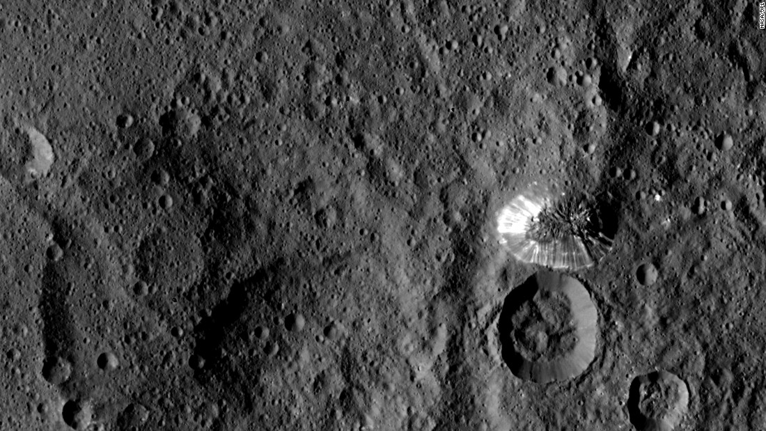"This tall, <a href=""http://www.nasa.gov/jpl/dawn-sends-sharper-scenes-from-ceres"" target=""_blank"">conical mountain on Ceres</a> was photographed from a distance of 915 miles (1,473 kilometers) by NASA's Dawn spacecraft. The mountain, located in the dwarf planet's southern hemisphere, is 4 miles (6.4 kilometers) high. The photo was taken on August 19, 2015."