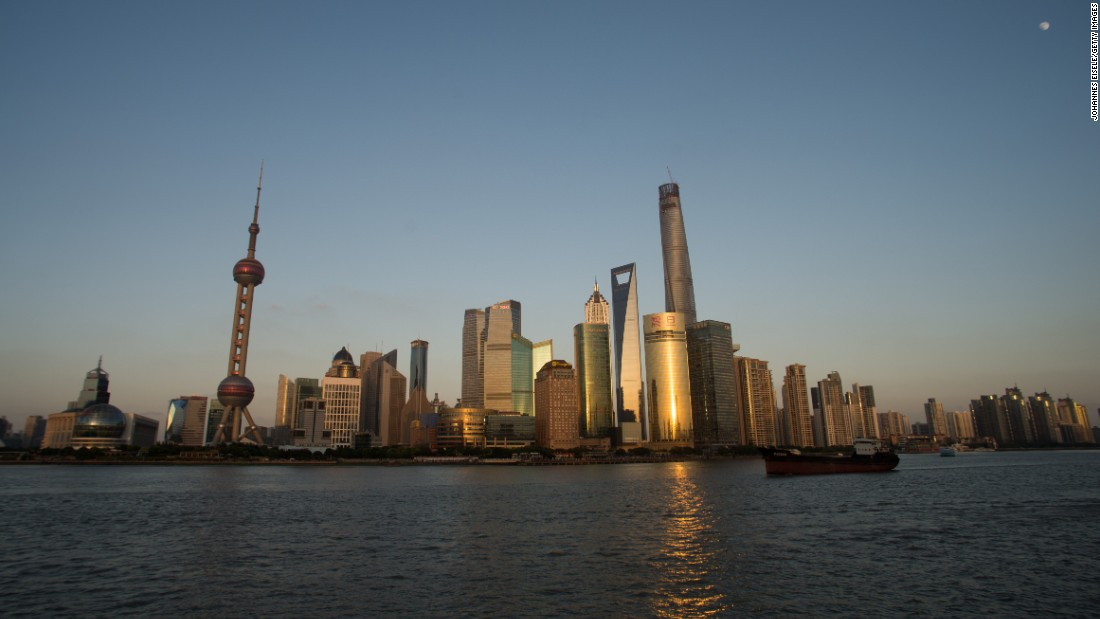 Shanghai Tower, right, is the world's second-tallest building at 2,073 feet (632 meters). The city's Oriental Pearl radio and TV tower, left, is a recognizable landmark in the Pudong district.