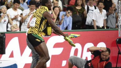 "Jamaica's Usain Bolt reacts after a cameraman on a segway crashed into him in the final of the men's 200 metres athletics event at the 2015 IAAF World Championships at the ""Bird's Nest"" National Stadium in Beijing on August 27, 2015. AFP PHOTO / FRANCK FIFE        (Photo credit should read FRANCK FIFE/AFP/Getty Images)"