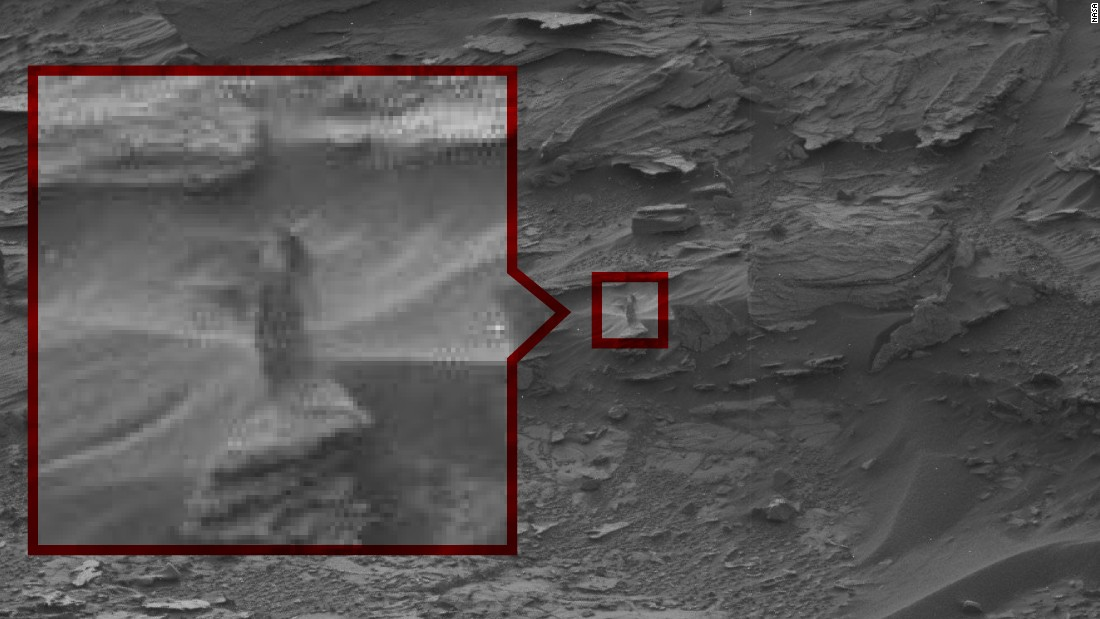 "The Strange Lady: This ghost-like ""woman"" seems to peering down at Curiosity from a cliff. NASA says it's probably just an oddly shaped drift of sand."