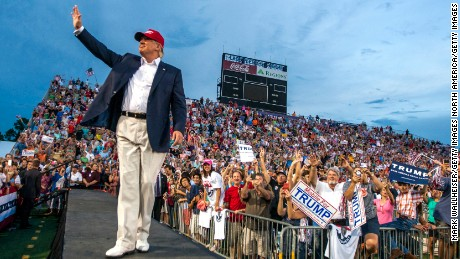U.S. Republican presidential candidate Donald Trump takes the stage at Ladd-Peebles Stadium on August 21, 2015 in Mobile, Alabama.