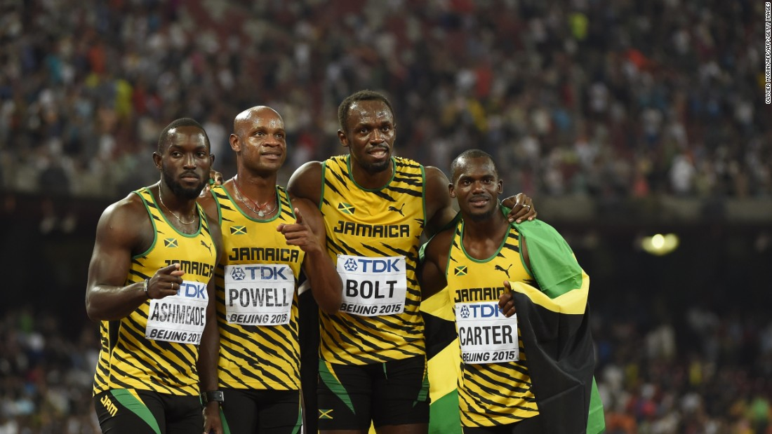 The Jamaican relay team (L-R) Nickel Ashmeade, Asafa Powell,Usain Bolt and Nesta Carter pose for photographers after winning the final of the men's 4x100 metres relay event.