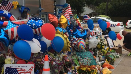 Mourners created a memorial at the gas station where Goforth was killed.