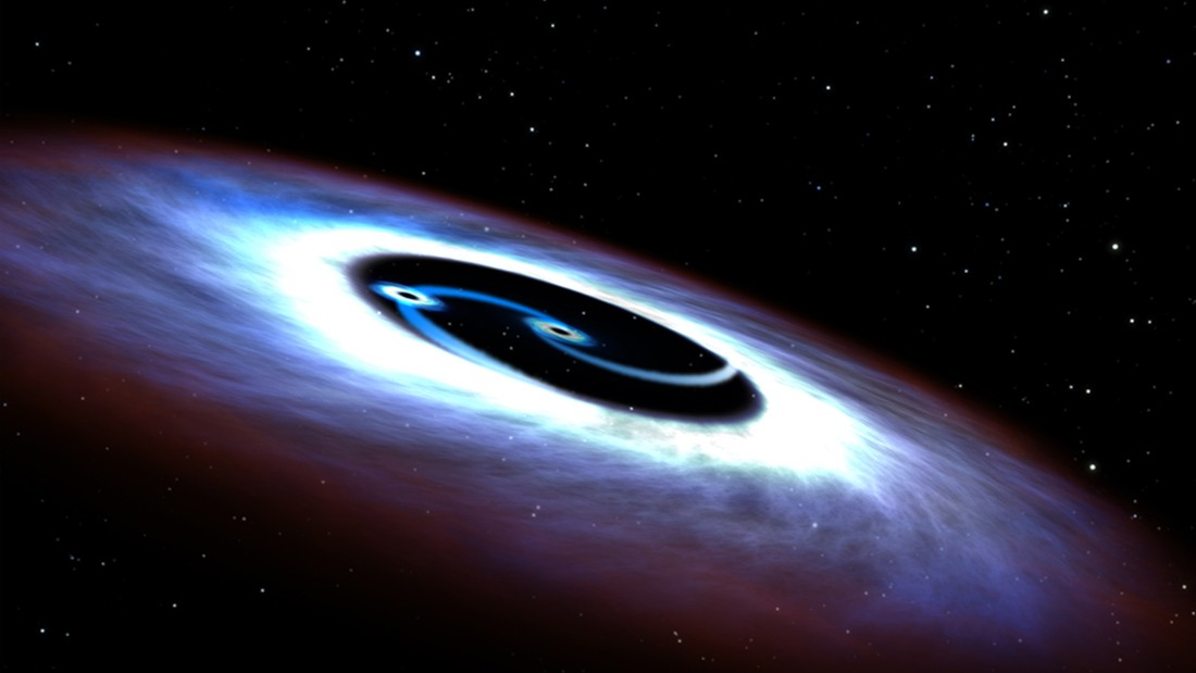 An artists illustration of a binary black hole found in the center of the nearest quasar to Earth, Markarian 231.