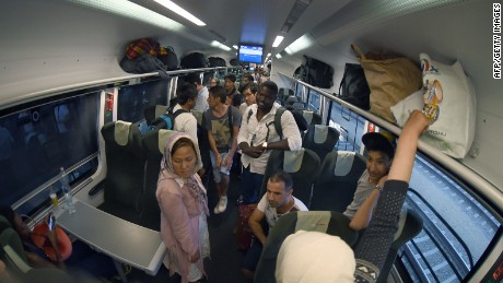 Migrants travel on a train from Budapest shortly before arrival at Vienna's Westbahnhof railway station on August 31, 2015. Up to 300 migrants have arrived from Budapest to Vienna, Austria. Austrian security forces stopped two trains with several hundred migrants near the border with Hungary on Monday, a police spokesman said, hours after authorities in Budapest let them leave despite many not having EU visas. AFP PHOTO / JOE KLAMARJOE KLAMAR/AFP/Getty Images