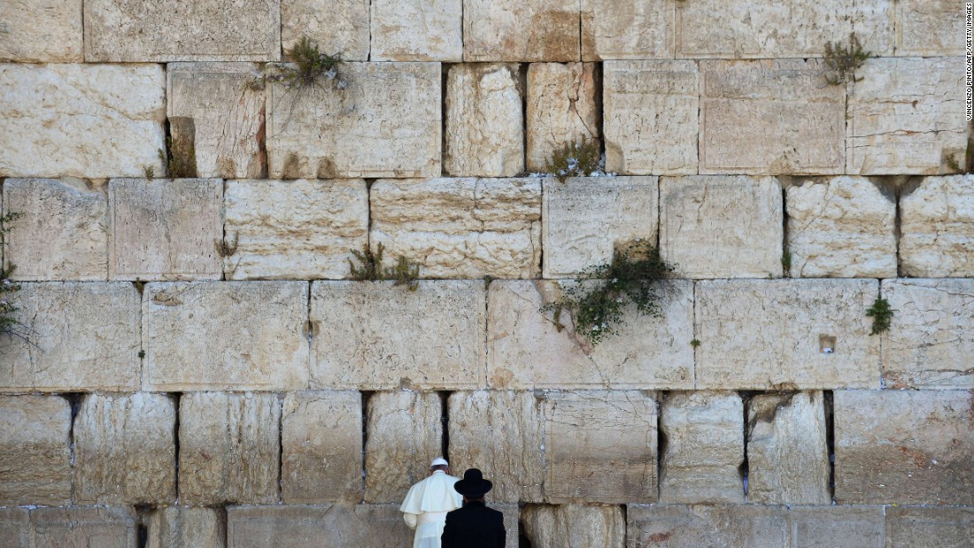 "Pope Francis prays next to a rabbi at the Western Wall in Jerusalem's Old City in May 2014. The Pope went on a <a href=""http://www.cnn.com/2014/05/24/world/gallery/pope-holy-land/index.html"">three-day trip to the Holy Land</a>, and he was accompanied by Jewish and Muslim leaders from his home country of Argentina."