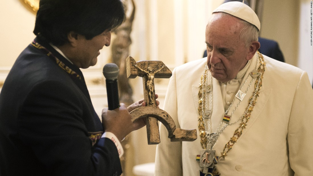 Bolivian President Evo Morales presents the Pope with a gift of a crucifix carved into a wooden hammer and sickle -- the Communist symbol uniting laborers and peasants -- in La Paz, Bolivia, on Wednesday, July 8.
