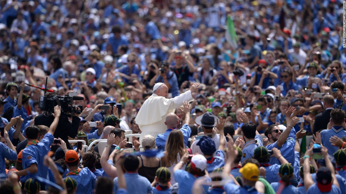 Pope Francis greets a crowd of Italian Catholic boy scouts and girl guides at St. Peter's Square on Saturday, June 13.