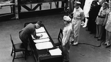 2nd September 1945:  General Douglas MacArthur (1880 - 1964) as Supreme Commander of the Allied Forces accepts the unconditional surrender document signed by the Japanese Yoshijiro Umezu and watched by representatives of the Allied Nations. They are on board the USS Missouri in Tokyo Bay.