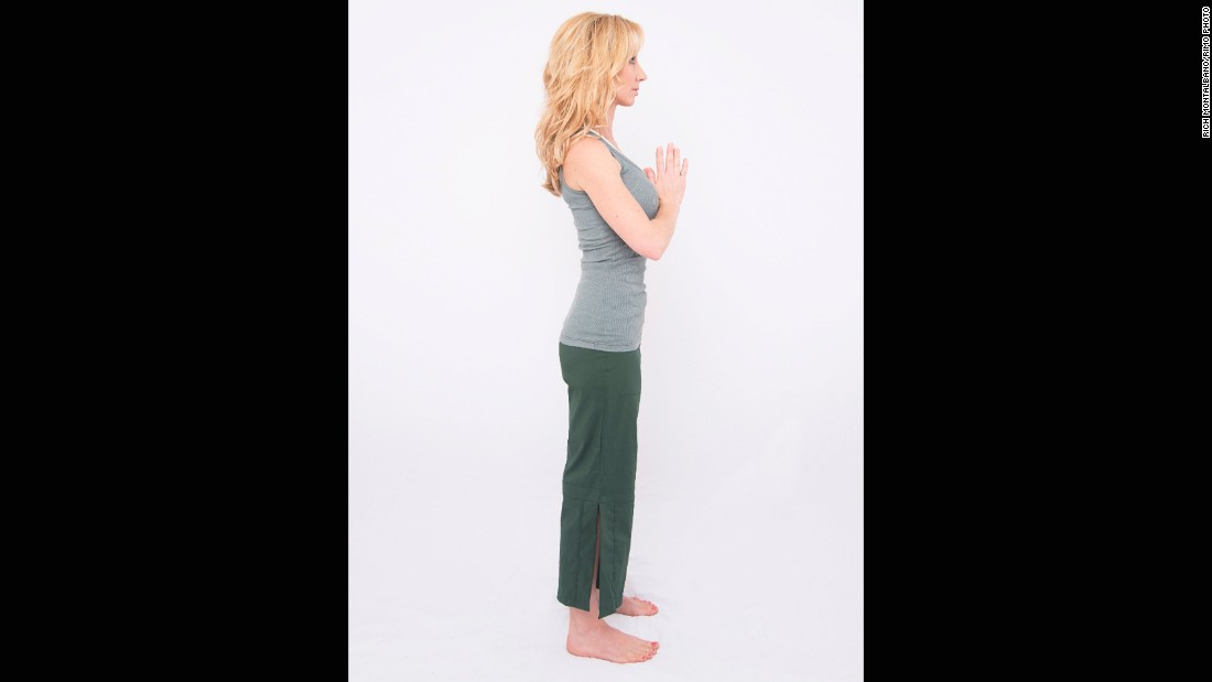 When you first get out of bed, stand with feet hip distance and palms together at the center of your chest.<br />