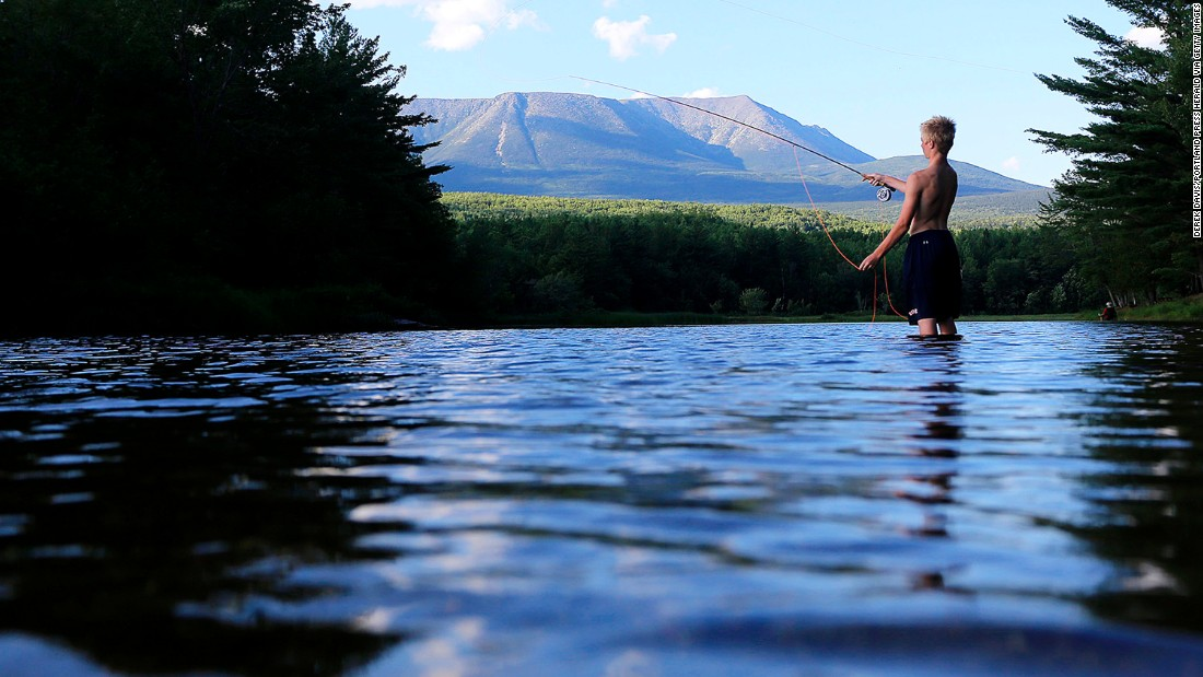 """Mount Katahdin looms beyond the West Branch on the Penobscot River near Abol Bridge in Maine. The northernmost point of the Appalachian Trail, the mountain's Penobscot Indian name means """"the Greatest Mountain."""""""