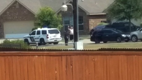 Cell phone video obtained by CNN appears to show sheriff's deputies in Bexar County, Texas, shooting and killing Gilbert Flores, 41, Friday, August 28, 2015. Flores is shown in this frame, taken second before Flores was shot, wearing a white shirt with his hands in the air.