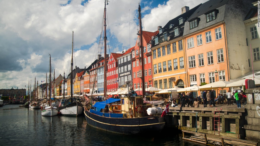 <strong>Nyhavn, Copenhagen:</strong> Denmark is officially the world's happiest country. There's nowhere more Danish to experience life than Nyhavn, the old port in Copenhagen that's now home to restaurants and music along the canal.