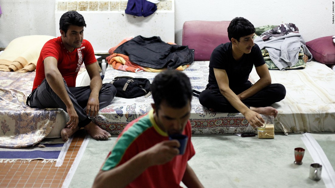 Migrants from Afghanistan drink tea at a Paris school where they found shelter.