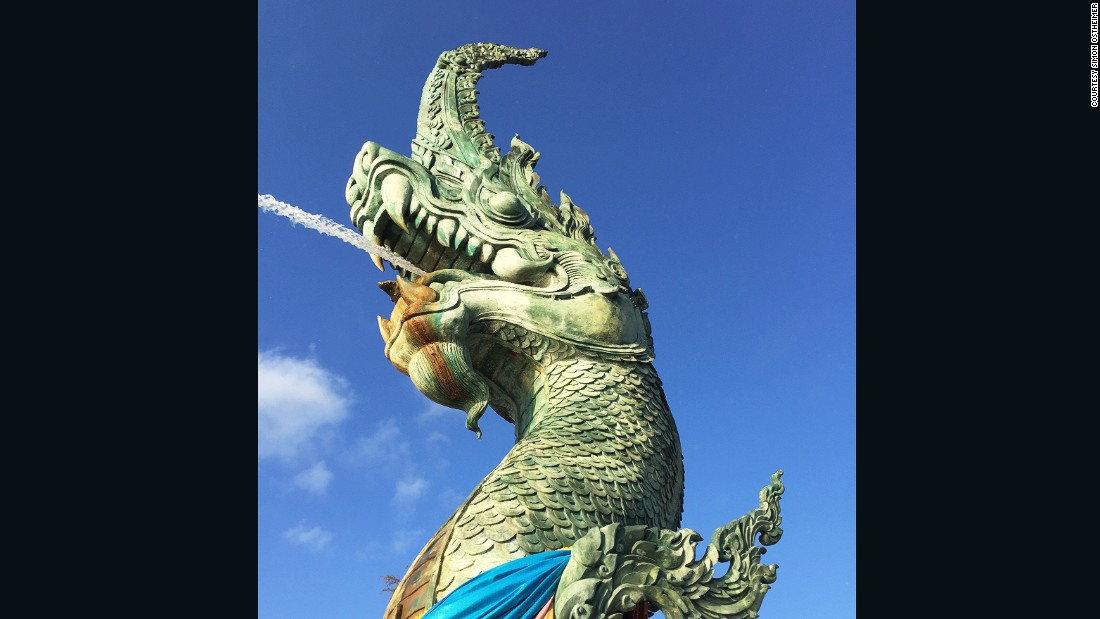 "The Naga Head (""dragonhead"") statue is the centerpiece of Song Thale Park near Songkhla Lake."