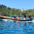 Thailand southern cities Tourists-on-longtail-off-Koh-Kradan