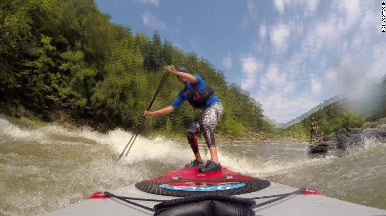 Stand-up paddleboarders tackle rapids