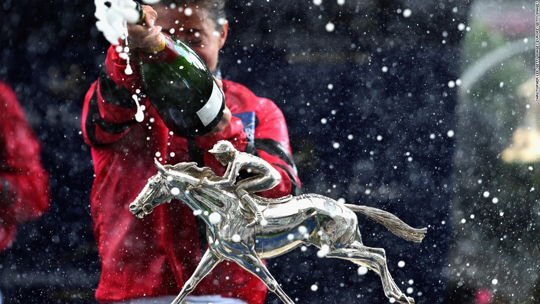 ASCOT, ENGLAND - AUGUST 08:  The Shergar Cup is seen as Hayley Turner sprays champagne during the Dubai Duty Free Shergar Cup at Ascot Racecourse on August 8, 2015 in Ascot, England.  (Photo by Christopher Lee/Getty Images)