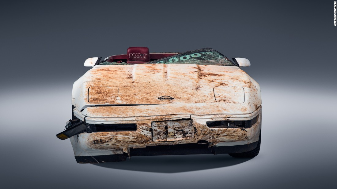 The white LT1 convertible roadster came off the assembly line in 1992. Last year, the sinkhole did this to it. Note the severe damage to the hood, the windshield and the front fascia.