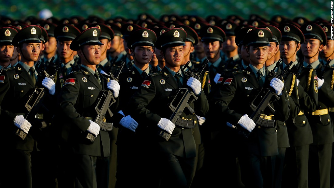 People's Liberation Army troops arrive at Tiananmen Gate in formation for the parade on September 3.