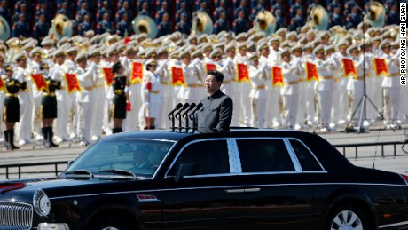 Chinese President Xi Jinping stands in a car to review the army during a parade commemorating the 70th anniversary of Japan's surrender during World War II held in front of Tiananmen Gate in Beijing, Thursday, Sept. 3, 2015. The spectacle involved more than 12,000 troops, 500 pieces of military hardware and 200 aircraft of various types, representing what military officials say is the Chinese military's most cutting-edge technology.