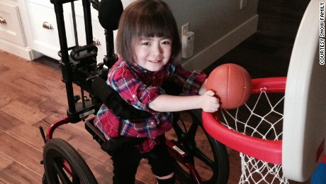 Julianna used to turn circles in her wheelchair. Now her hands are too weak to work the controls.
