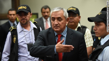 Guatemalan ex-President Otto Perez speaks with journalists at the end of a hearing at the Supreme Court in Guatemala City on September 3, 2015. Judge Miguel Angel Galvez ordered the detention Thursday of Guatemala's disgraced president Otto Perez, hours after he resigned his post amid a massive corruption scandal.