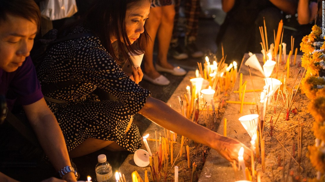 Visitors gather around the base of the Erawan Shrine on August 24, 2015 to commemorate the victims of the bomb attack in Bangkok, Thailand.