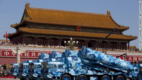 BEIJING, CHINA - SEPTEMBER 03: Military vehicles carry DF-10 ship launched cruise missiles, drive past the Tiananmen Gate during a military parade to mark the 70th anniversary of the end of World War Two on September 3, 2015 in Beijing, China. China is marking the 70th anniversary of the end of World War II and its role in defeating Japan with a new national holiday and a military parade in Beijing. (Photo by Andy Wong - Pool /Getty Images)
