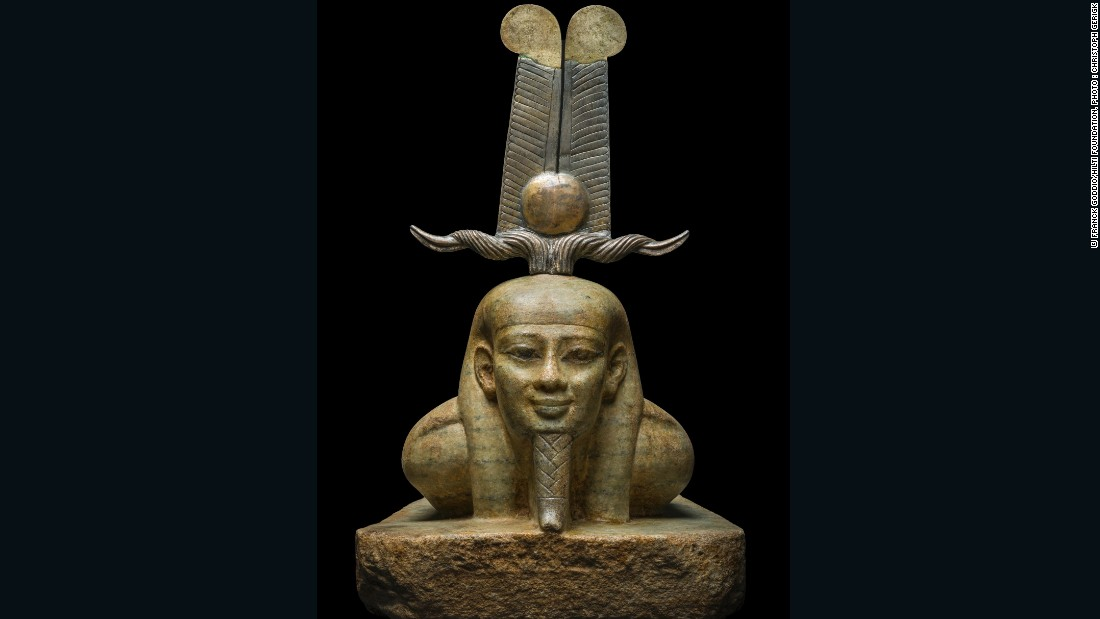"This spectacular sculpture gneiss (a stone similar to granite) dates back to the 26th Dynasty. It shows the resurrection of the god Osiris.  He is dressed with a crown known as ""tchenie"" (which means ""rise up"") while Its materials (gold, bronze, electrum) evoke the radiations of the celestial sun."