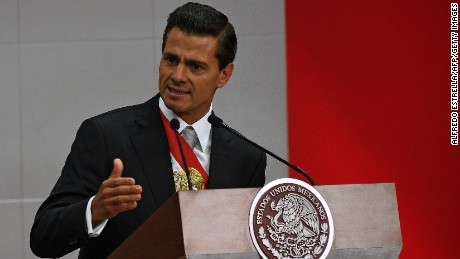 "Mexican President Enrique Pena Nieto delivers his third annual report at the National Palace in Mexico City on September 2, 2015. Mexico's embattled President Enrique Pena Nieto acknowledged his country's ""outrage"" over a drug kingpin's jailbreak, the presumed massacre of 43 students and other scandals in his state-of-the-nation speech Wednesday."