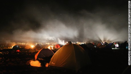 SZEGED, HUNGARY - SEPTEMBER 06:  Exhausted migrants light camp fires and sleep in a field after crossing the border from Serbia into Hungary along the railway tracks close to the village of Roszke on September 6, 2015 in Szeged, Hungary. After days of confrontation and chaos, Hungary unexpectedly opened its borders with Austria, allowing thousands of migrants to leave the country and travel onto Germany.  (Photo by Christopher Furlong/Getty Images)